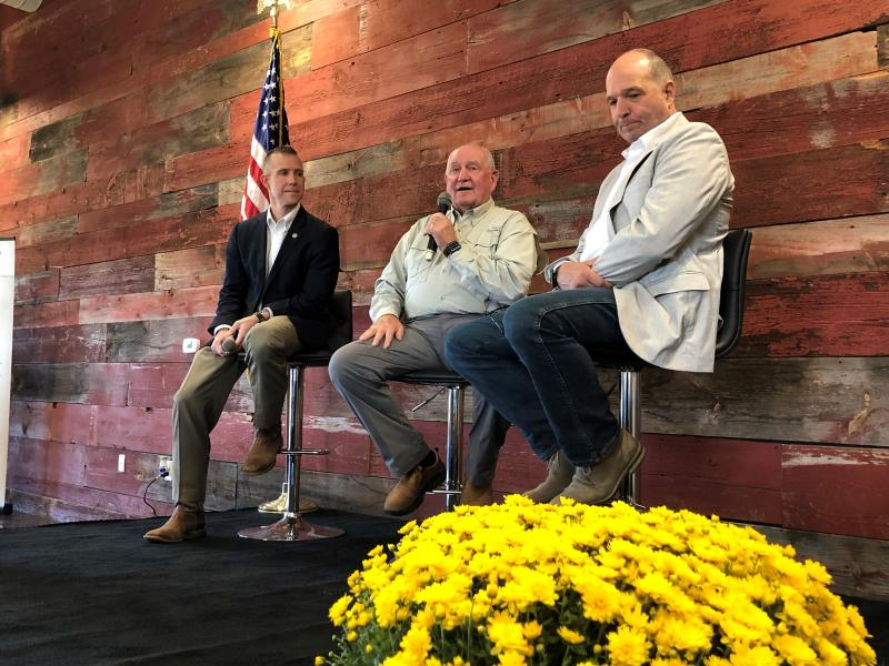 U.S. Secretary of Agriculture Sonny Perdue, center, speaks to members of the agriculture industry during a town hall meeting on Friday, Oct. 18, 2019, in Memphis, Tenn. Seated alongside Perdue are Arkansas Secretary of Agriculture Wes Ward (left) and Tennessee Secretary of Agriculture Charlie Hatcher, right. (AP Photo/Adrian Sainz)