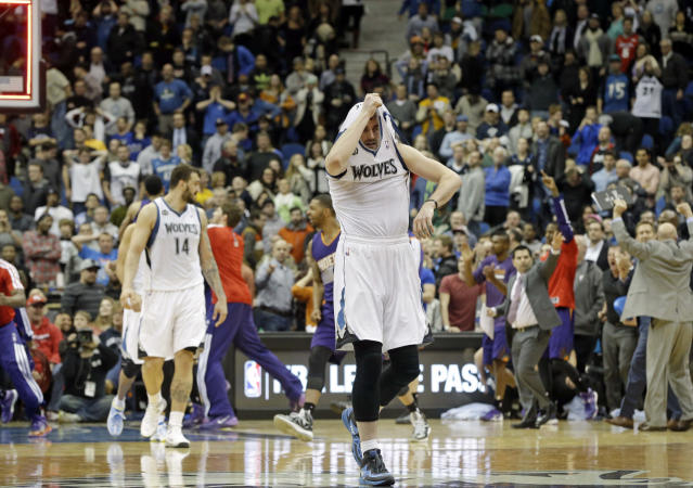 Minnesota Timberwolves' Kevin Love pulls his jersey over his head as he leaves the court after the Phoenix Suns came from behind to beat the Timberwolves 104-103 in an NBA basketball game Wednesday, Jan. 8, 2014, in Minneapolis. (AP Photo/Jim Mone)