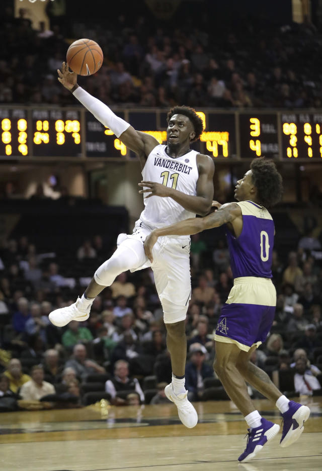 Vanderbilt forward Simisola Shittu (11) drives past Alcorn State guard Troymain Crosby (0) in the second half of an NCAA college basketball game Friday, Nov. 16, 2018, in Nashville, Tenn. Vanderbilt won 79-54. (AP Photo/Mark Humphrey)