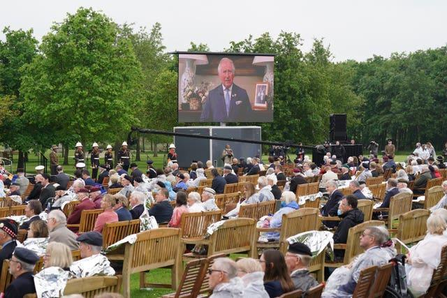 Veterans watch the official opening of the British Normandy Memorial
