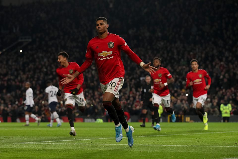 MANCHESTER, ENGLAND - DECEMBER 04: Marcus Rashford of Manchester United celebrates after scoring a goal to make it 2-1 during the Premier League match between Manchester United and Tottenham Hotspur at Old Trafford on December 4, 2019 in Manchester, United Kingdom. (Photo by Matthew Ashton - AMA/Getty Images)