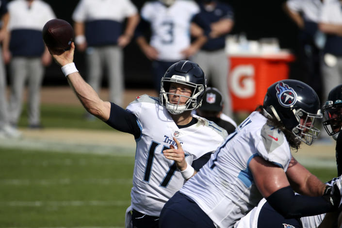 Tennessee Titans quarterback Ryan Tannehill throws a pass against the Jacksonville Jaguars during the first half of an NFL football game, Sunday, Dec. 13, 2020, in Jacksonville, Fla. (AP Photo/Stephen B. Morton)