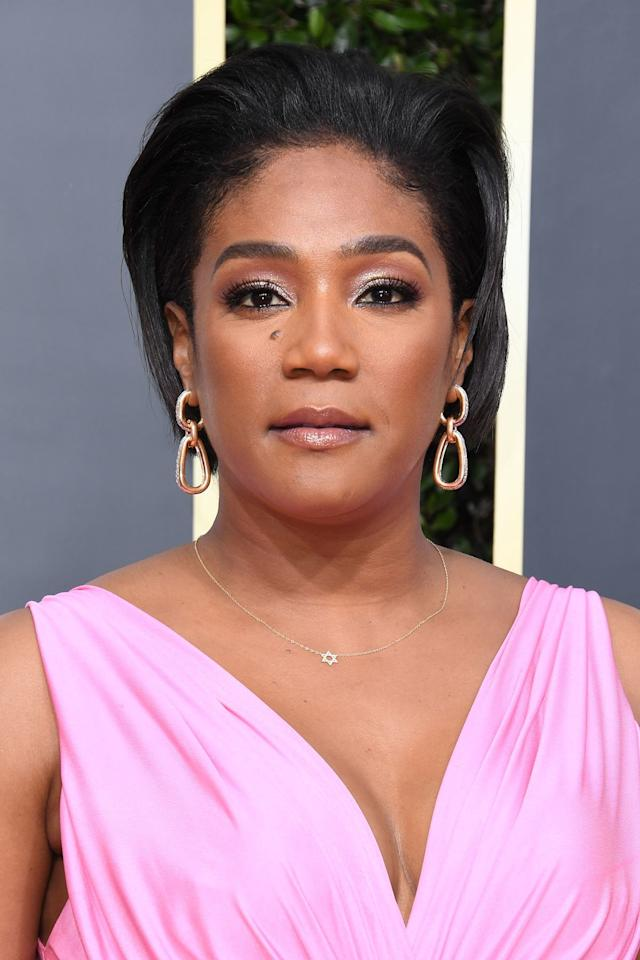 """<p>The rumors aren't true: It <em>is </em>possible to<em> </em>pull your hair up and out of your face when you have a bob. Just look at how Tiffany Haddish wore the front sections of her bob pushed back at the 2020 Golden Globes. Her stylist <a href=""""https://www.instagram.com/hair4kicks/"""" target=""""_blank"""">Ray Christopher</a> used a flat iron to straighten the star's hair and lift her roots. He ran <a href=""""http://goto.walmart.com/c/249354/565706/9383?subId1=IS%2C2020BobHairstyles%2Clukase%2C%2CIMA%2C3514526%2C202001%2CI&u=https%3A%2F%2Fwww.walmart.com%2Fip%2FSuave-Professionals-for-Natural-Hair-Define-Shine-Gel-Serum-4-75-oz%2F111677724"""" target=""""_blank"""">Suave Professionals for Natural Hair Define & Shine Serum</a> through the voluminous style for a smooth, shiny finish. </p>"""