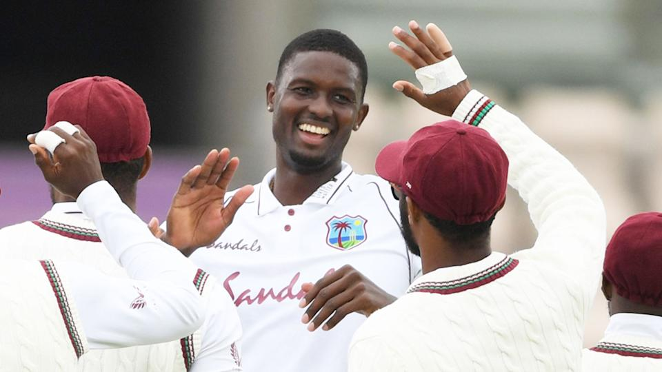 Seen here, Windies captain Jason Holder celebrates one of his six wickets against England.