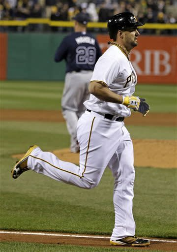 Pittsburgh Pirates' Gaby Sanchez, foreground, runs home past Atlanta Braves starting pitcher Paul Maholm (28) after hitting a two-run home run during the sixth inning of a baseball game in Pittsburgh, Saturday, April 20, 2013. (AP Photo/Gene J. Puskar)