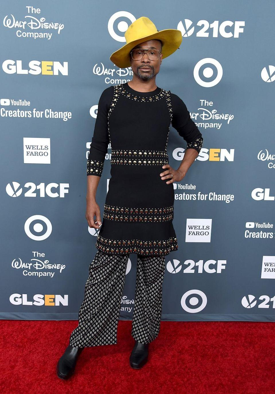 <p>Porter at the GLSEN Respect Awards in a three-quarter-sleeved, studded black dress, printed silk pants, and a yellow hat. </p>
