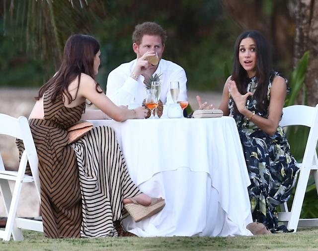 <p>The prince introduced Markle to all of his friends while attending the wedding of Tom Inskip and Lara Hughes-Young in Jamaica. The pair was spotted eating and drinking together with the actress wearing a gorgeous Erdem gown. (Photo: FameFlynet) </p>