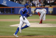 New York Mets' Rajai Davis, left, runs between third and home on his eighth-inning, three-run home run in the team's baseball game against the Washington Nationals, Wednesday, May 22, 2019, in New York, as Nationals relief pitcher Sean Doolittle, right, reacts on the mound. (AP Photo/Kathy Willens)