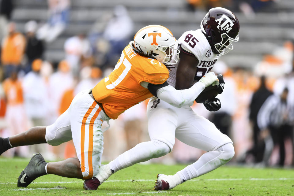 Tennessee linebacker Quavaris Crouch (27) tackles Texas A&M tight end Jalen Wydermyer (85) during an NCAA college football game in Neyland Stadium in Knoxville, Tenn., Saturday, Dec. 19, 2020. (Brianna Paciorka/Knoxville News Sentinel via AP, Pool)