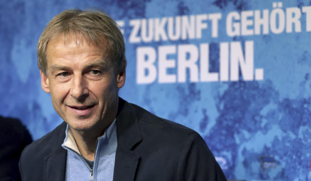 FILE - In this Wednesday, Nov. 27, 2019 file photo, Juergen Klinsmann speaks during a press conference of German Bundesliga soccer team Hertha BSC Berlin in Berlin. Klinsmann needs to show Germany's soccer federation, known as the DFB, a valid coaching license to remain officially recognized as head coach of his new club Hertha Berlin as he prepares for their game on Sunday, Jan. 19, 2020 against defending champion Bayern Munich. (AP Photo/Michael Sohn, file)