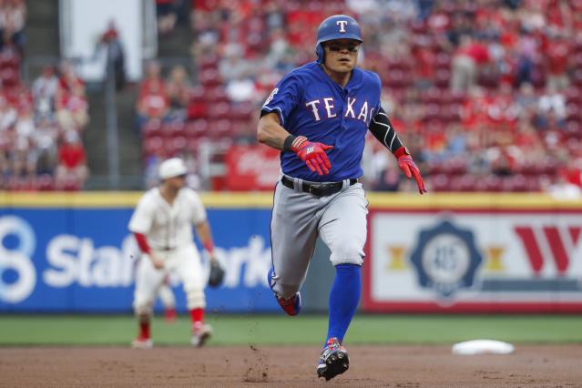 Texas Rangers' Shin-Soo Choo runs to third on a single by Danny Santana off Cincinnati Reds starting pitcher Tanner Roark during the first inning of a baseball game Saturday, June 15, 2019, in Cincinnati. (AP Photo/John Minchillo)
