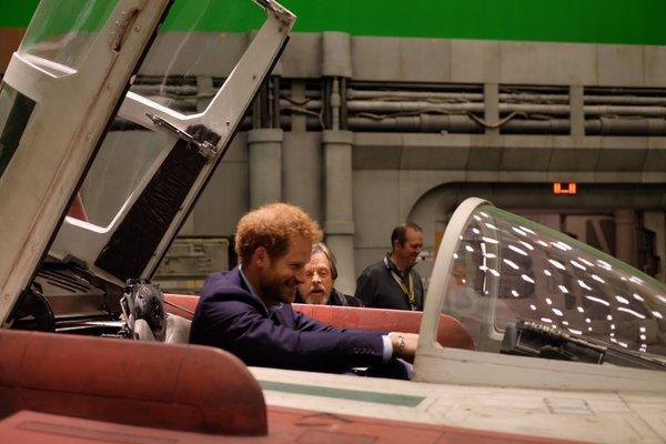 """<p>Prince Harry gets some piloting advice from former <a href=""""http://starwars.wikia.com/wiki/Red_Five"""">Red Five</a> ace Mark Hamill. <i>(Photo: <a href=""""https://twitter.com/KensingtonRoyal?ref_src=twsrc%5Egoogle%7Ctwcamp%5Eserp%7Ctwgr%5Eauthor"""">Twitter/Kensington Palace</a>)</i></p>"""