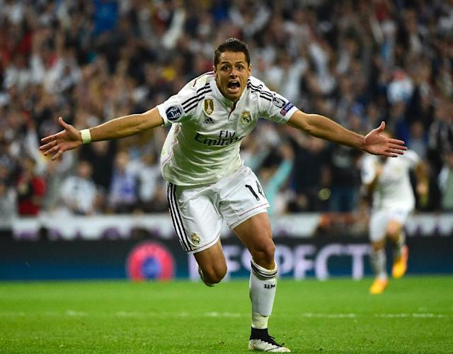 Real Madrid's Mexican forward Javier Hernandez celebrates after scoring a goal during the UEFA Champions League quarter-finals second leg football match Real Madrid CF vs Club Atletico de Madrid in Madrid on April 22, 2015 (AFP Photo/Pierre-Philippe Marcou)
