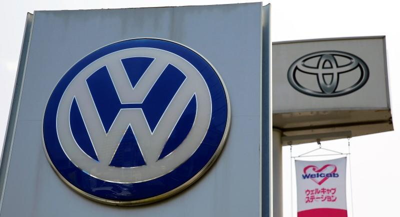 File photo of the logos of Volkswagen and Toyota Motor Corp at their dealership in Tokyo
