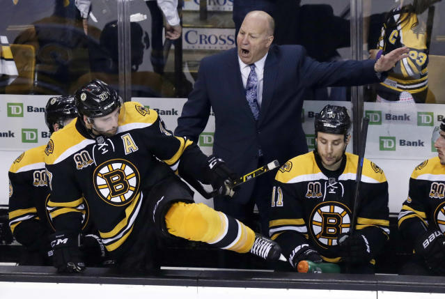 Boston Bruins head coach Claude Julien, center, yells as center Patrice Bergeron climbs over the boards to face the Montreal Canadiens during the third period of Game 1 in the second-round of the Stanley Cup playoff series in Boston, Thursday, May 1, 2014. (AP Photo/Charles Krupa)