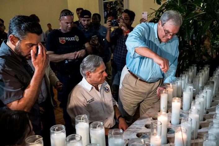 El Paso Mayor Dee Margo (R, pictured August 3, 2019 at a vigil ceremony for mass shooting victims) seemed to discount any race angle to the shooting, but even some Republicans saw that sort of explanation as inadequate (AFP Photo/Joel Angel JUAREZ)