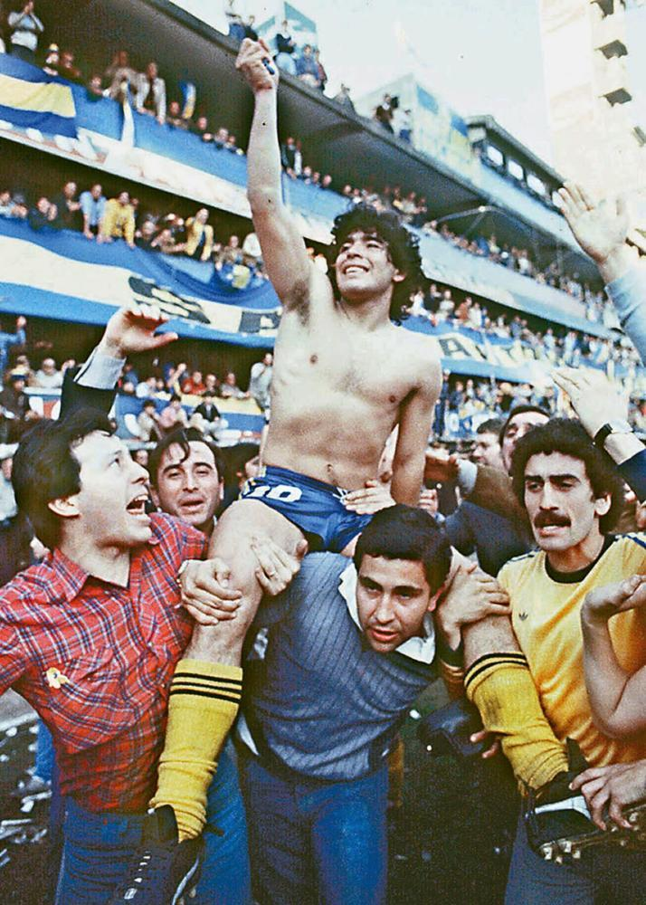 Diego Maradona being carried by fans after winning the local championship with Boca Juniors in Buenos Aires in 1981.