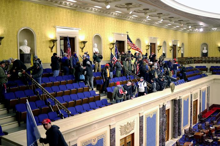 Image: Protesters enter the Senate Chamber on Jan. 6, 2021. (Win McNamee / Getty Images file)