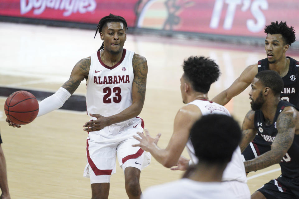 Alabama guard John Petty Jr. (23) hands the ball off during the second half of an NCAA college basketball game against South Carolina Tuesday, Feb. 9, 2021, in Columbia, S.C. Alabama won 81-78. (AP Photo/Sean Rayford)