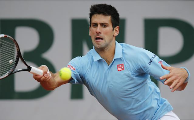 Serbia's Novak Djokovic returns the ball during the third round match of the French Open tennis tournament against Croatia's Marin Cilic at the Roland Garros stadium, in Paris, France, Friday, May 30, 2014. (AP Photo/David Vincent)