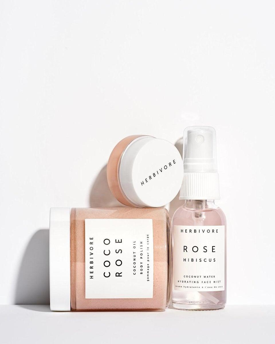 """<h3>Herbivore Coco Rose Luxe Hydration Trio</h3><br>At a much lower price point, you can score this petal-pink Herbivore Botanicals trio — a rosewater <a href=""""https://www.refinery29.com/en-us/best-face-mist-reviews"""" rel=""""nofollow noopener"""" target=""""_blank"""" data-ylk=""""slk:face mist"""" class=""""link rapid-noclick-resp"""">face mist</a>, <a href=""""https://www.refinery29.com/en-us/2017/11/179586/best-body-scrub-exfoliator-winter"""" rel=""""nofollow noopener"""" target=""""_blank"""" data-ylk=""""slk:body scrub"""" class=""""link rapid-noclick-resp"""">body scrub</a>, and <a href=""""https://www.refinery29.com/en-us/lip-balm"""" rel=""""nofollow noopener"""" target=""""_blank"""" data-ylk=""""slk:lip balm"""" class=""""link rapid-noclick-resp"""">lip balm</a> — all of which all double as chic bathroom decor.<br><br><strong>Herbivore Botanicals</strong> Herbivore Coco Rose Luxe Hydration Trio, $, available at <a href=""""https://go.skimresources.com/?id=30283X879131&url=https%3A%2F%2Fwww.herbivorebotanicals.com%2Fproducts%2Fcoco-rose-luxe-hydration-trio"""" rel=""""nofollow noopener"""" target=""""_blank"""" data-ylk=""""slk:Herbivore Botanicals"""" class=""""link rapid-noclick-resp"""">Herbivore Botanicals</a>"""