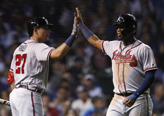 Atlanta Braves' Ronald Acuna Jr., right, celebrates with Austin Riley after scoring a run against the Chicago Cubs during the sixth inning of a baseball game Monday, June 24, 2019, in Chicago. (AP Photo/Jim Young)