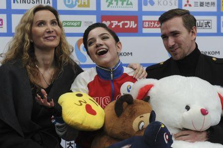 Figure Skating - ISU Grand Prix Rostelecom Cup 2017 - Ladies' Free Skating - Moscow, Russia - October 21, 2017 - Evgenia Medvedeva of Russia and her team members react after the performance. REUTERS/Alexander Fedorov