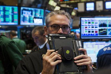 A trader works on the floor of the New York Stock Exchange shortly after the opening bell in New York August 26, 2015. REUTERS/Lucas Jackson