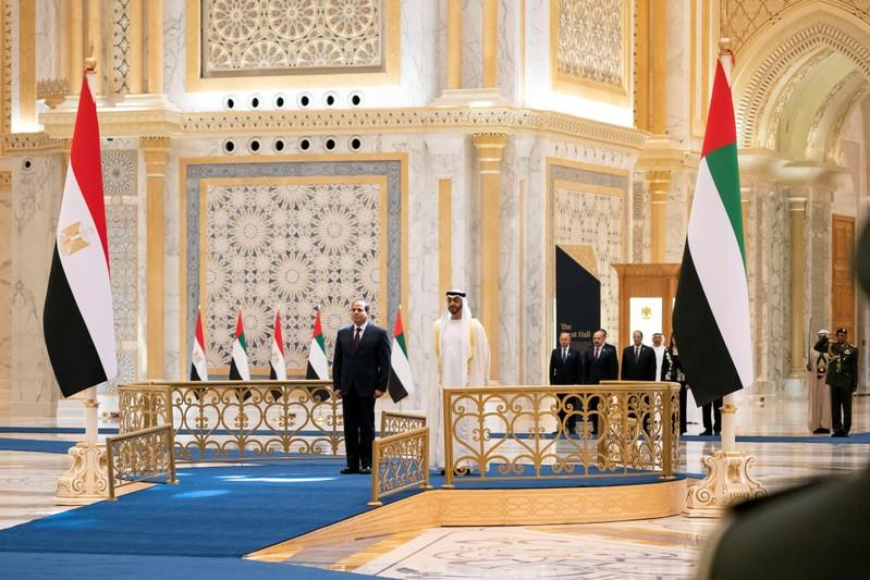 Abu Dhabi's Crown Prince Sheikh Mohammed bin Zayed al-Nahyan and Egyptian President Abdel Fattah al-Sisi are seen during a welcome cermony in Abu Dhabi