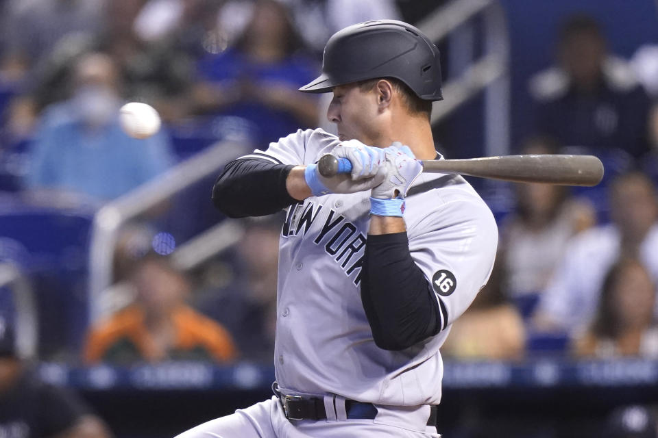 New York Yankees' Anthony Rizzo moves away before being hit by a pitch thrown by Miami Marlins starter Trevor Rogers during the second inning of a baseball game, Saturday, July 31, 2021, in Miami. (AP Photo/Lynne Sladky)