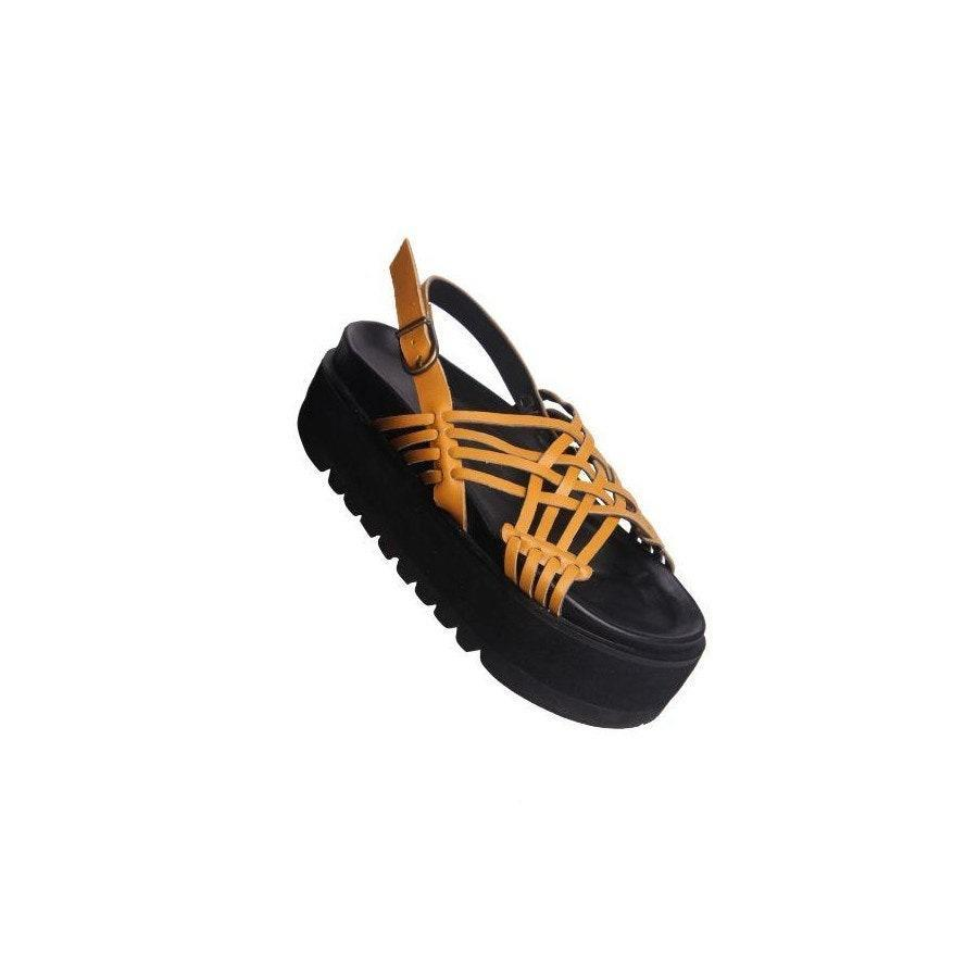 "<p>These handmade Maliko Platform Sandals will add a skip to any cool mom's step, thanks to their customizable colorways and chunky soles. The most notable feature, however, is the designer sources the rubber soles from upcycled truck tires.</p> <p><strong>$190</strong> (<a href=""https://malikostudios.com/products/onike-woven-yellow"" rel=""nofollow noopener"" target=""_blank"" data-ylk=""slk:Shop Now"" class=""link rapid-noclick-resp"">Shop Now</a>)</p>"