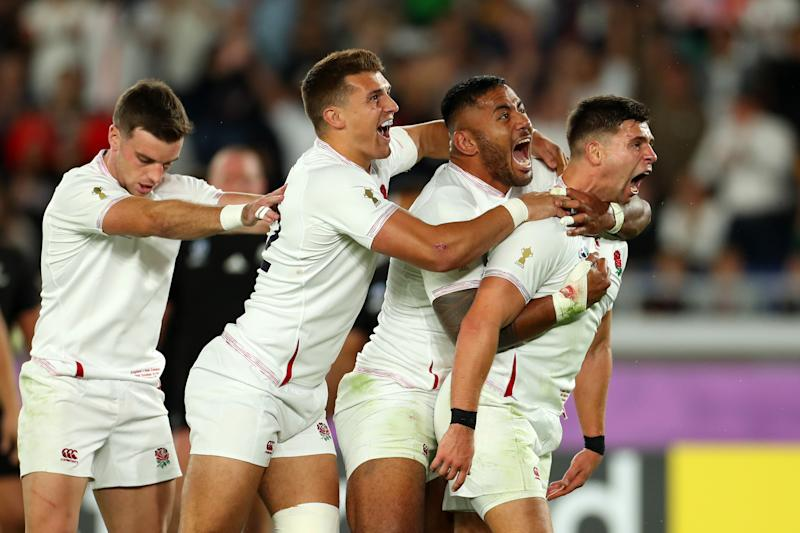 YOKOHAMA, JAPAN - OCTOBER 26: Ben Youngs of England celebrates with Henry Slade and Manu Tuilagi of England after scoring a try prior to being disallowed during the Rugby World Cup 2019 Semi-Final match between England and New Zealand at International Stadium Yokohama on October 26, 2019 in Yokohama, Kanagawa, Japan. (Photo by Shaun Botterill/Getty Images)