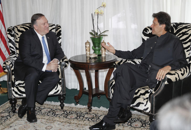 Secretary of State Mike Pompeo, left, meets with Pakistani Prime Minister Imran Khan, right, at the Residence of the Pakistani Ambassador in Washington, Tuesday, July 23, 2019. (AP Photo/Pablo Martinez Monsivais)