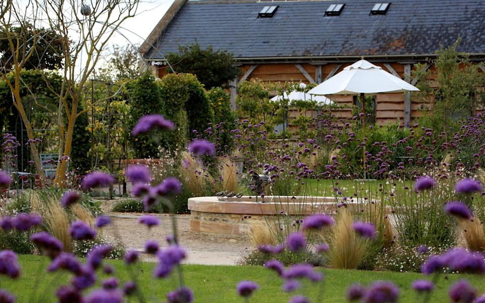 Work that paid off: View of the Ox Barn garden, designed by Bunny Guinness - Clara Molden