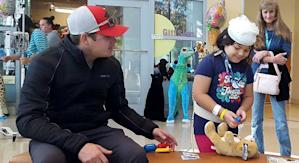 Noah Gragson interacts with a child