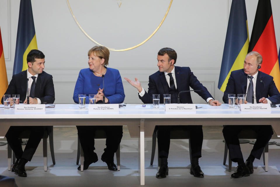 Ukraine's President Volodymyr Zelenskiy, left, German Chancellor Angela Merkel, French President Emmanuel Macron and Russian President Vladimir Putin, right, attend a joint news conference at the Elysee Palace in Paris, Monday Dec. 9, 2019. Russian President Vladimir Putin and Ukrainian President Volodymyr Zelenskiy met for the first time Monday at a summit in Paris to try to end five years of war between Ukrainian troops and Russian-backed separatists. (Ludovic Marin/Pool via AP)