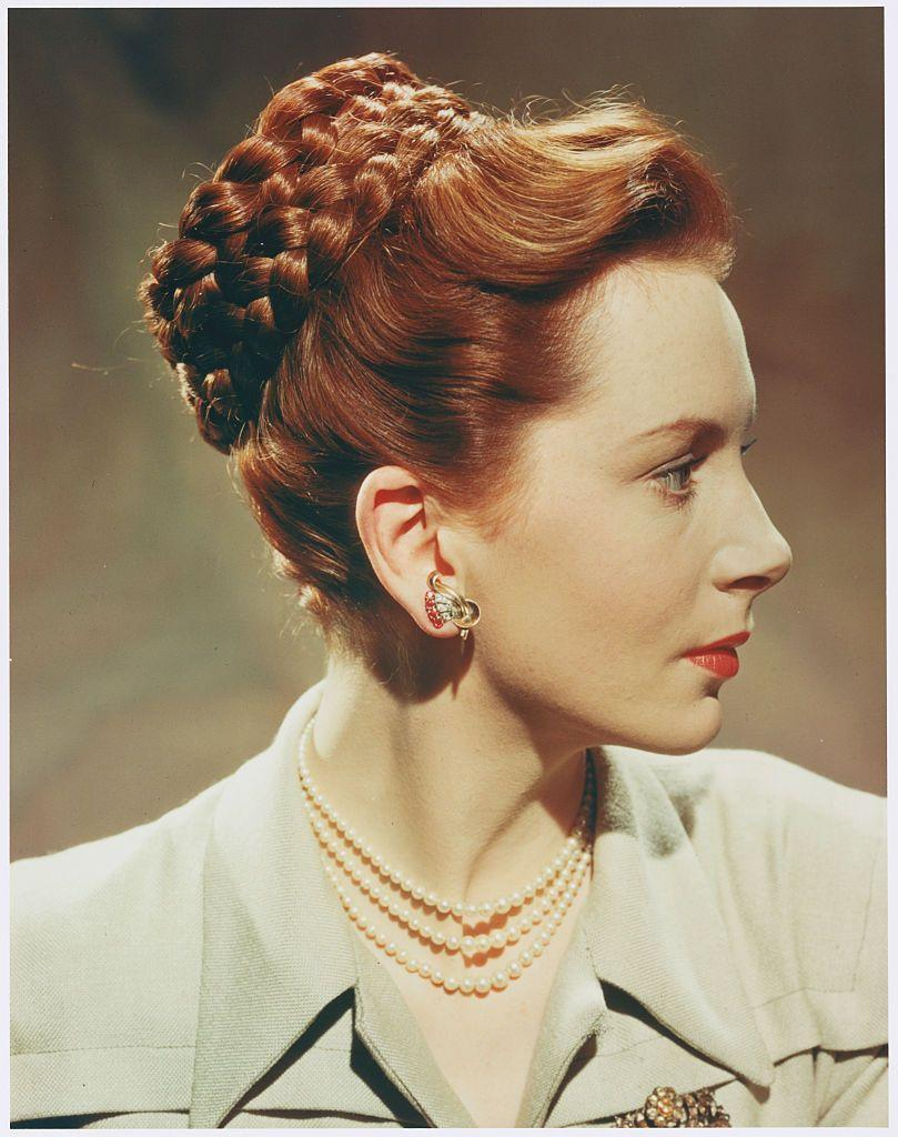 <p>While styles like the pompadour and poodle cut took over salons in the 1950s, British film star Deborah Kerr showed off a unique hairstyle of her own, featuring a coiled braid at the crown of her head. </p>