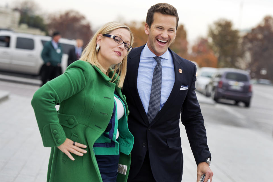 Reps. Kyrsten Sinema, D-Ariz., and Aaron Schock, R-Ill., say goodbye after at the bottom of the House Steps after the last vote of the week in the Capitol, December 4, 2014. (Tom Williams/CQ Roll Call via Getty Images)