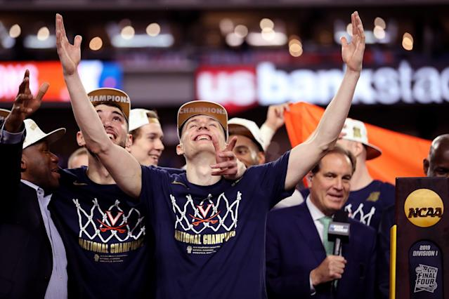 Kyle Guy, Ty Jerome and the Virginia Cavaliers celebrate their national championship. (Getty)