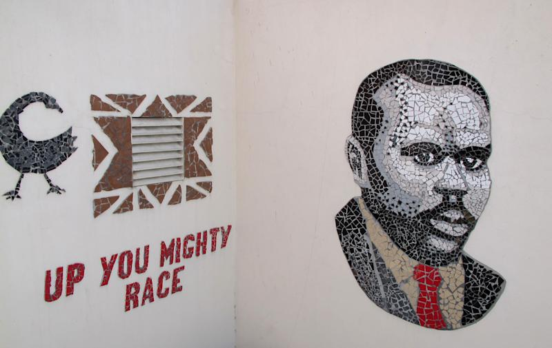 """In this Sept. 11, 2012 photograph, a mosaic of Marcus Garvey and one of his famed quotations are displayed in the courtyard of """"Liberty Hall,"""" a museum and community center in downtown Kingston, Jamaica. Jamaican students in every grade from kindergarten through high school are studying the teachings of the 1920s-era black nationalist leader in a new mandatory civics program in schools across this predominantly black country of 2.8 million people. (AP Photo/David McFadden)"""