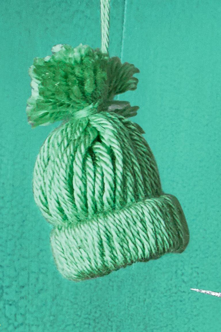 """<p>Hang cute, little knit hats of your tree to enforce extra cozy vibes in your home. Can you imagine how they'd look surrounded by twinkling lights?</p><p>Get the tutorial from <em><a href=""""https://www.womansday.com/life/how-to/a56960/how-to-make-a-knit-cap-ornament/"""" rel=""""nofollow noopener"""" target=""""_blank"""" data-ylk=""""slk:Woman's Day"""" class=""""link rapid-noclick-resp"""">Woman's Day</a></em>.</p>"""