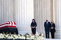 <p>Former President Bill Clinton and former Secretary of State Hillary Clinton pay respects as Justice Ruth Bader Ginsburg lies in repose at the top of the front steps of the U.S. Supreme Court in Washington on Wednesday, Sept. 23, 2020.</p>