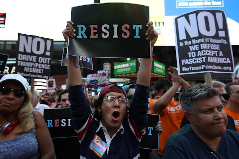 People protest U.S. President Donald Trump's announcement that he plans to reinstate a ban on transgender individuals from serving in any capacity in the U.S. military, in Times Square, in New York City, New York, U.S., July 26, 2017. REUTERS/Carlo Allegri