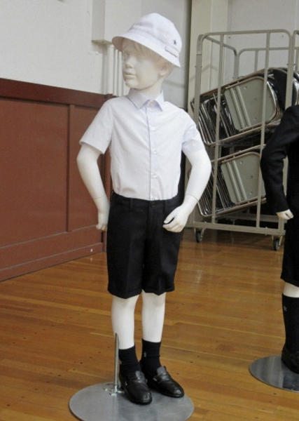 This undated photo provided by Taimei Elementary School shows new school uniform designed by Italian brand Armani. The Tokyo public school has adopted expensive Giorgio Armani uniforms for students, triggering criticism in a country where hefty school tuition is already burdening young parents.(Taimei Elementary School via AP)