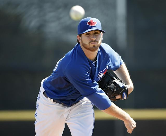 Toronto Blue Jays starting pitcher Drew Hutchison (36) delivers a warm-up pitch before starting in a spring training baseball game against the Minnesota Twins in Dunedin, Fla., Saturday, March 8, 2014. (AP Photo/Kathy Willens)