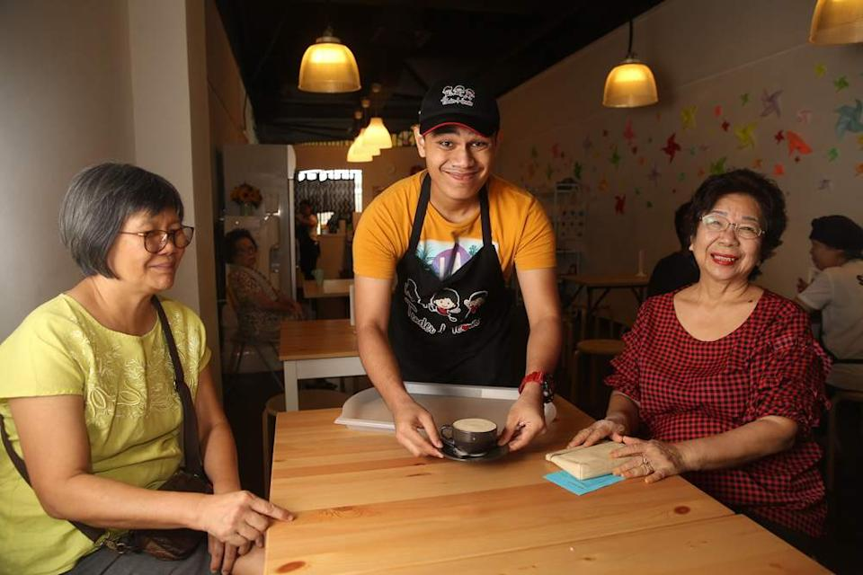 Danny serving customers at Tender Hearts, with a big smile on his face too. — Picture by Choo Choy May