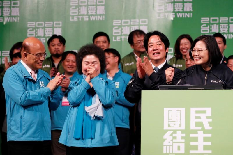 Premier Su Tseng-chang, Presidential Office Secretary-General Chen Chu, Vice President-elect William Lai, incumbent Taiwan President Tsai Ing-wen celebrate at a rally after their election victory in Taipei