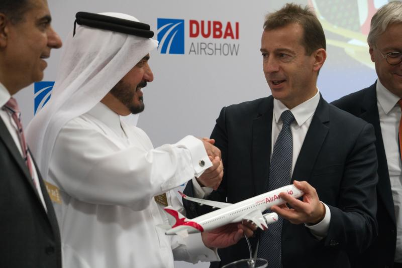 Airbus CEO Guillaume Faury, right, shakes hands with Air Arabia chairman Sheikh Abdullah bin Mohammed al-Thani at the Dubai Airshow in Dubai, United Arab Emirates, Monday, Nov. 18, 2019. The Emirati budget carrier Air Arabia announced Monday the purchase of 120 new Airbus planes in deal worth $14 billion. (AP Photo/Jon Gambrell)