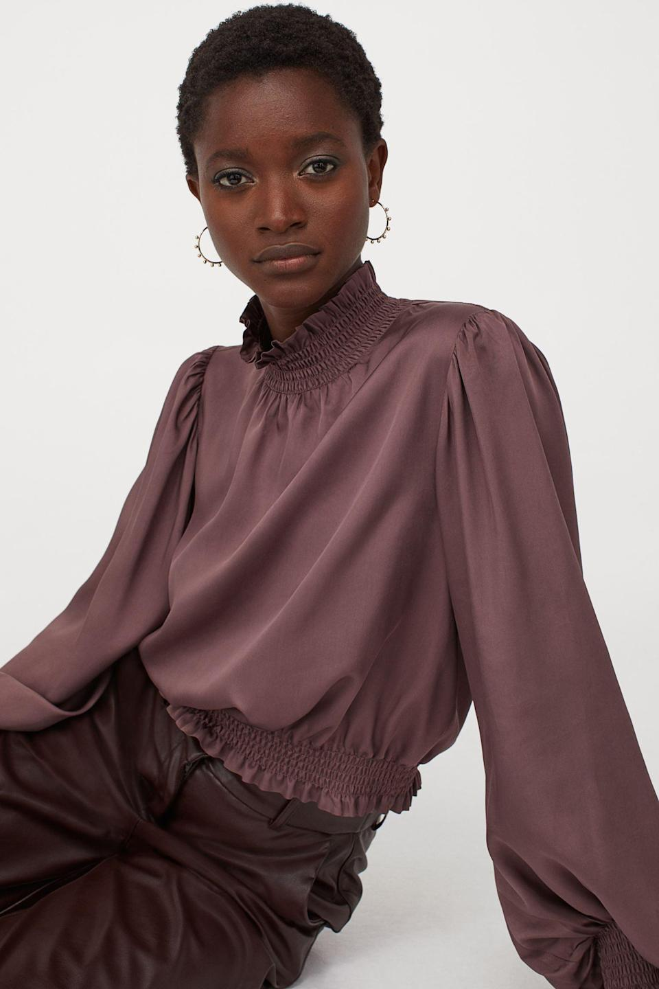 <p>Tuck this <span>Smock-detail Blouse</span> ($40) into matching pants or leather jeans for a statement monochrome look.</p>
