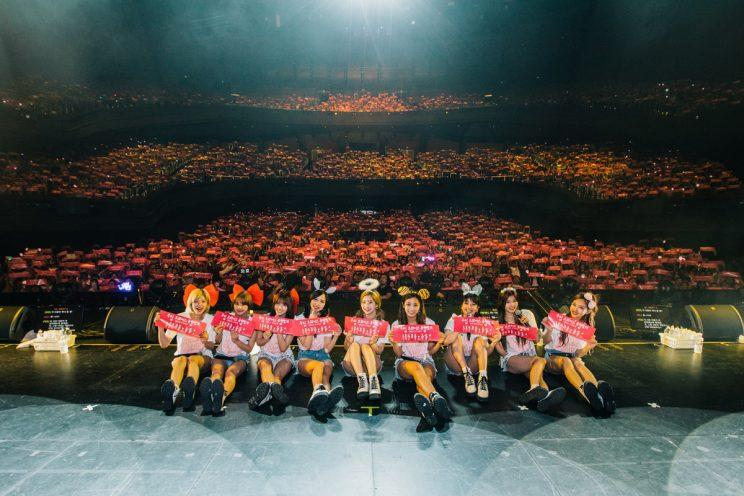 TWICE taking a photo with the crowd at their first concert in Singapore (Photo: ONE Production)